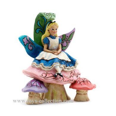 Alice assise sur le champignon