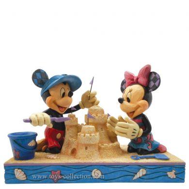 Mickey et Minnie chateau de sable sur la plage