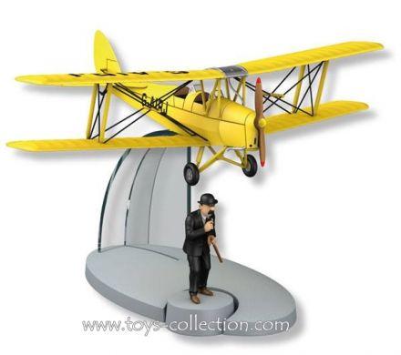 Biplan d'acrobaties jaune de l'Ile Noire et Dupond
