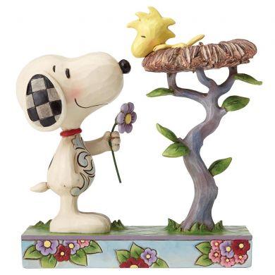 Snoopy offrant une fleur a Woodstock