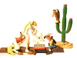 Lucky Luke jouant aux échecs avec Jolly Jumper