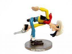 Lucky Luke tirant entre ses jambes