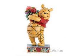 Winnie offre des fleurs